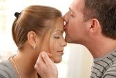 8747990-portrait-of-happy-couple-in-love-man-kissing-woman-on-forehead-stroking-face-with-eyes-closed