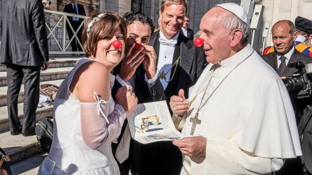 Pope Francis joking with newlywed couple