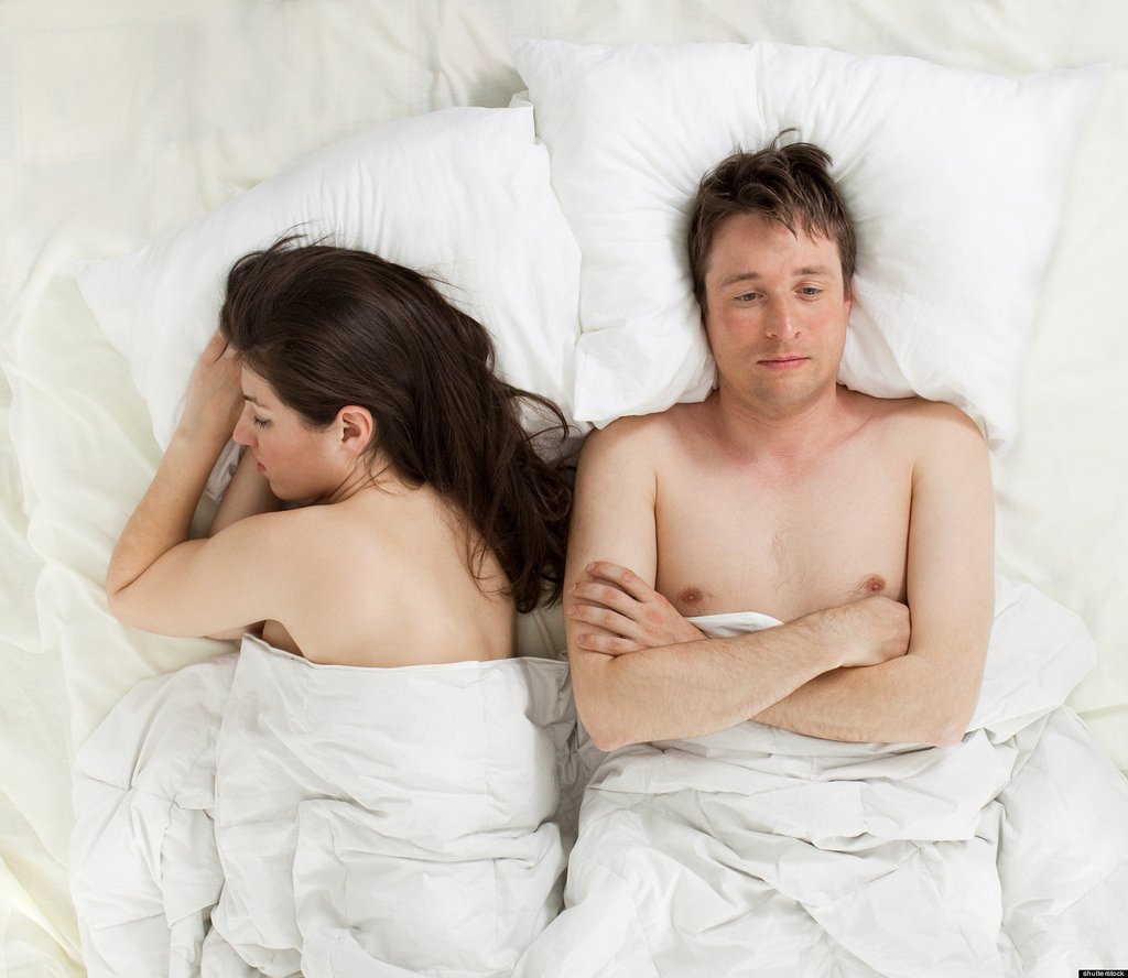 Husband and wife in bed